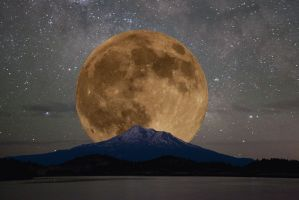 The harvest moon rising over Mount Shasta
